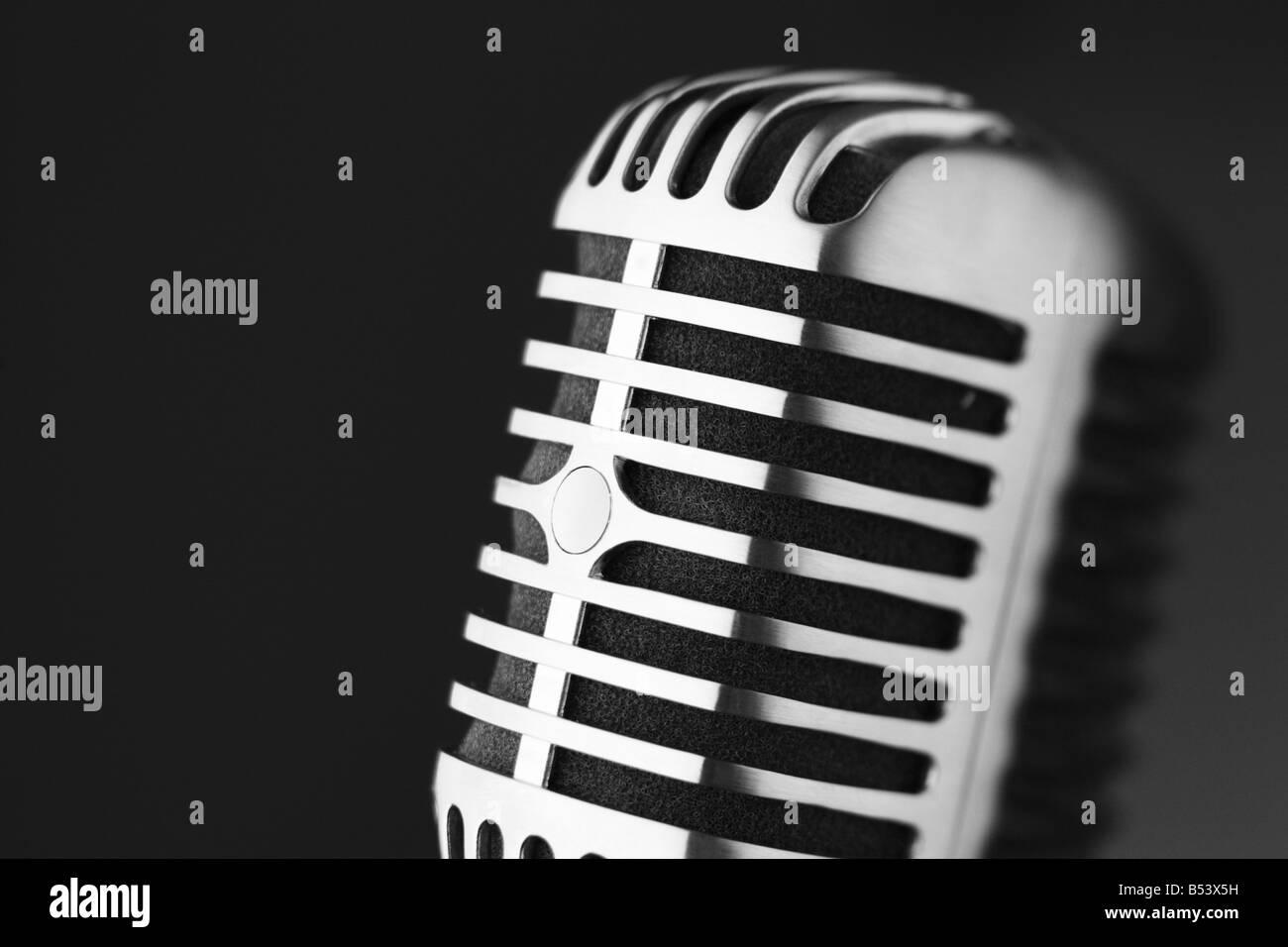 Classic retro microphone on black background selective focus - Stock Image