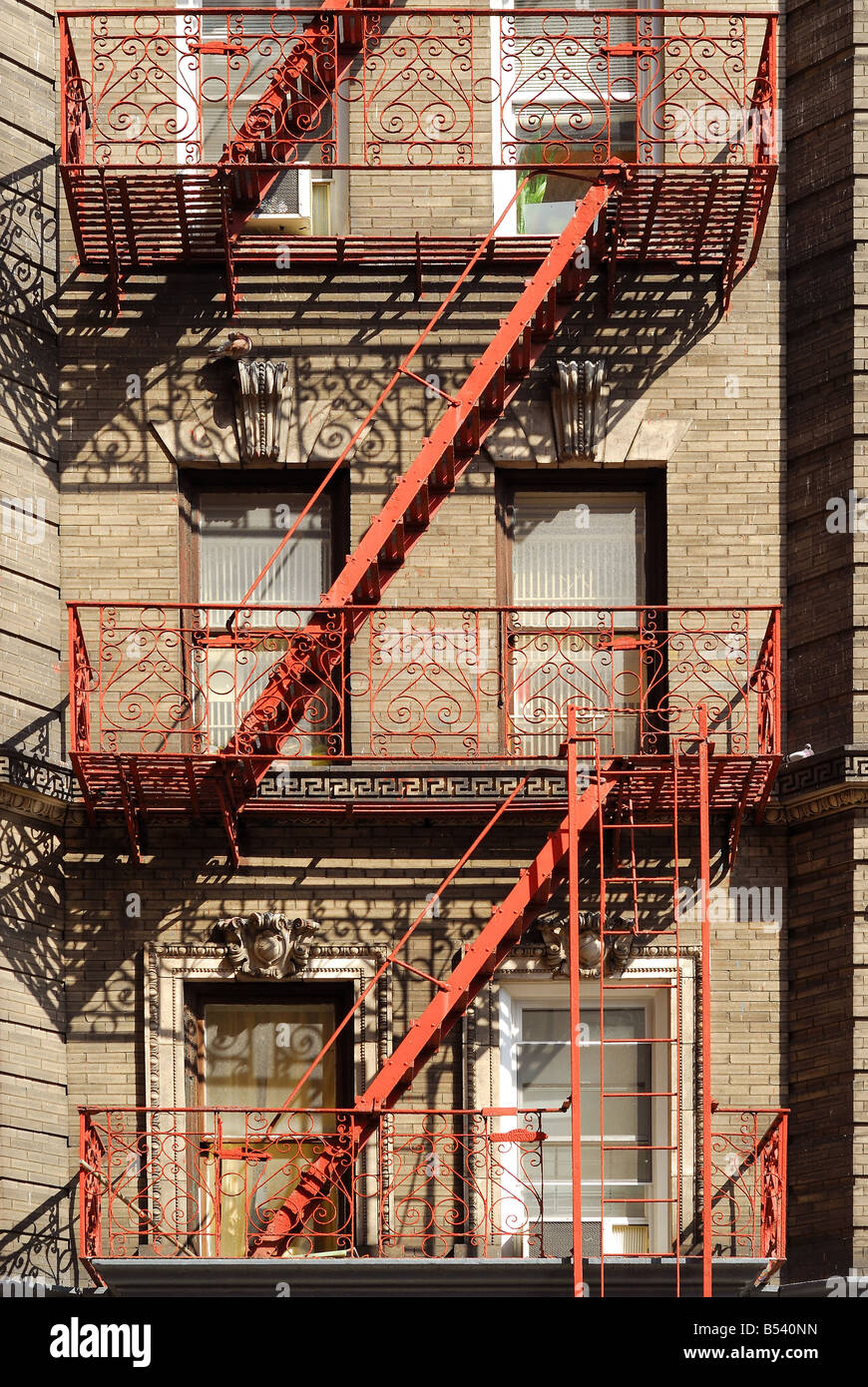 A neighborhood brick apartment with New York character as viewed from the street. Stock Photo
