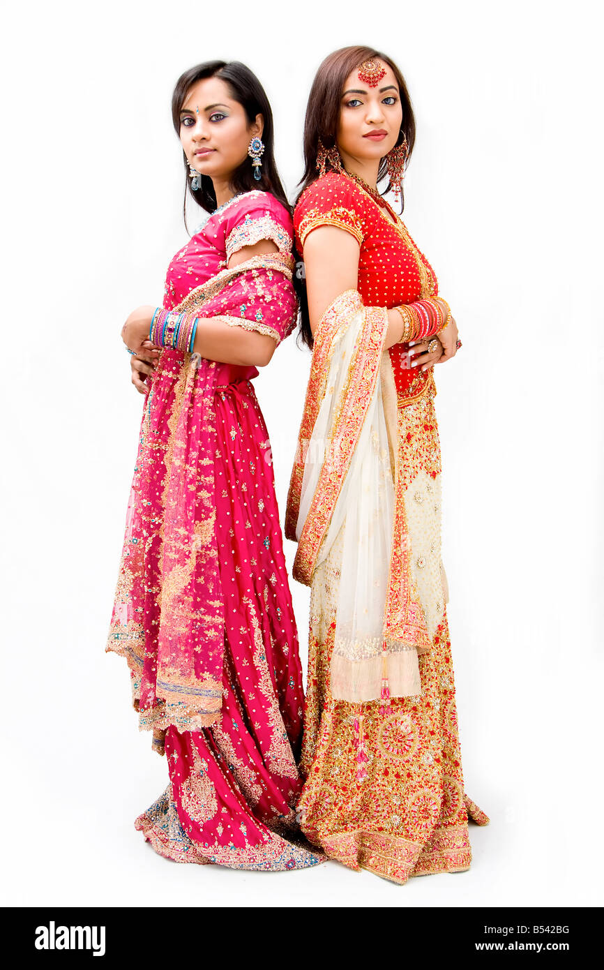 Two beautiful Bangali brides in colorful dresses isolated - Stock Image