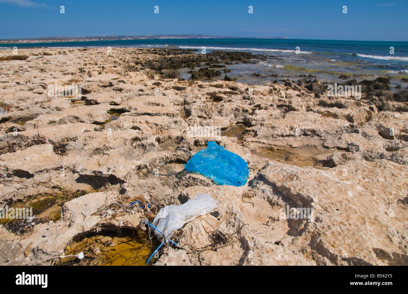 Plastic rubbish dumped on beach near Ayia Napa on the Mediterranean island of Cyprus EU - Stock Image