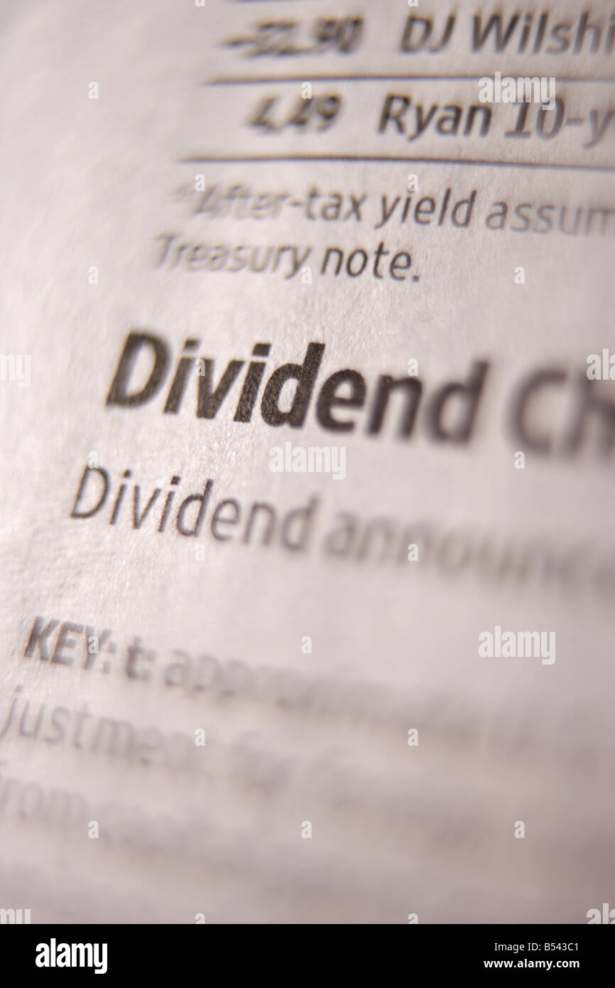 Close up of stock dividend prices in financial newspaper - Stock Image
