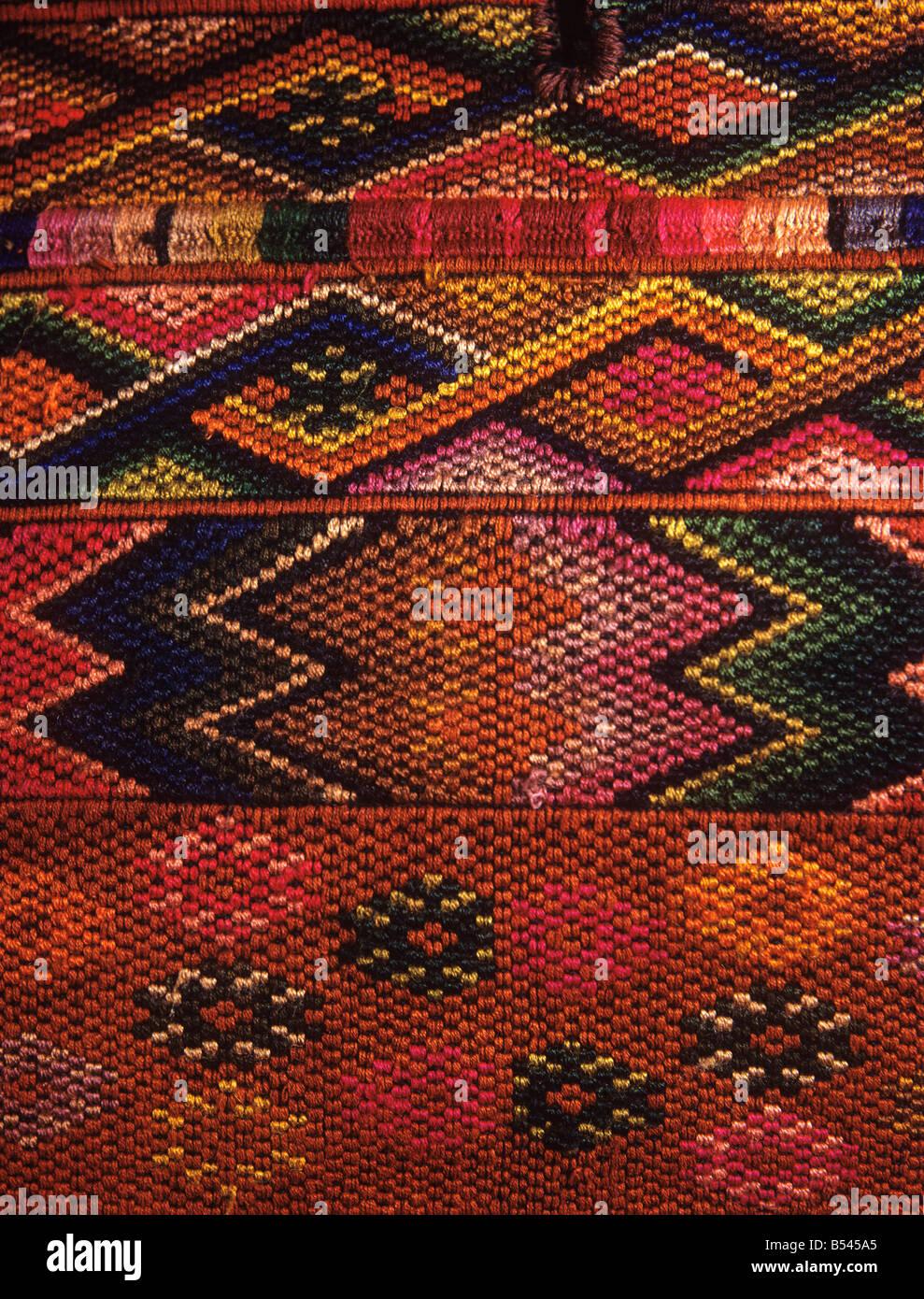 Guatemalan crafts detail of embroidered Hupile blouse from Lake Atitlan region of Guatemala - Stock Image