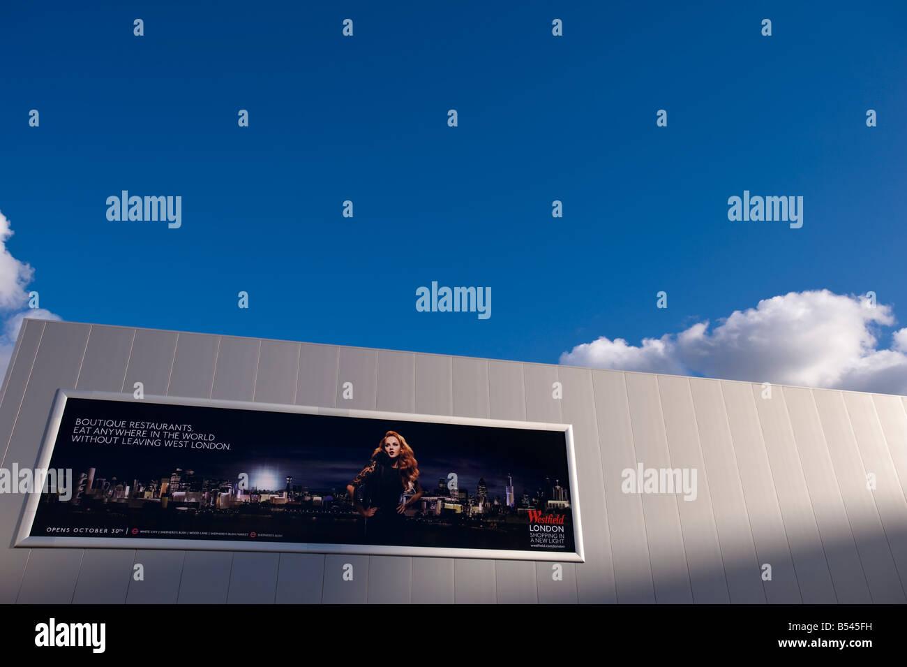 Billboard advertising newly built luxury Westfield Shopping Centre White City W12 London United Kingdom - Stock Image
