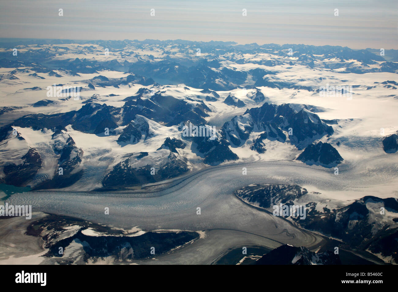 Aug 2008 - A view from the plane over the snow covered mountains Greenland - Stock Image