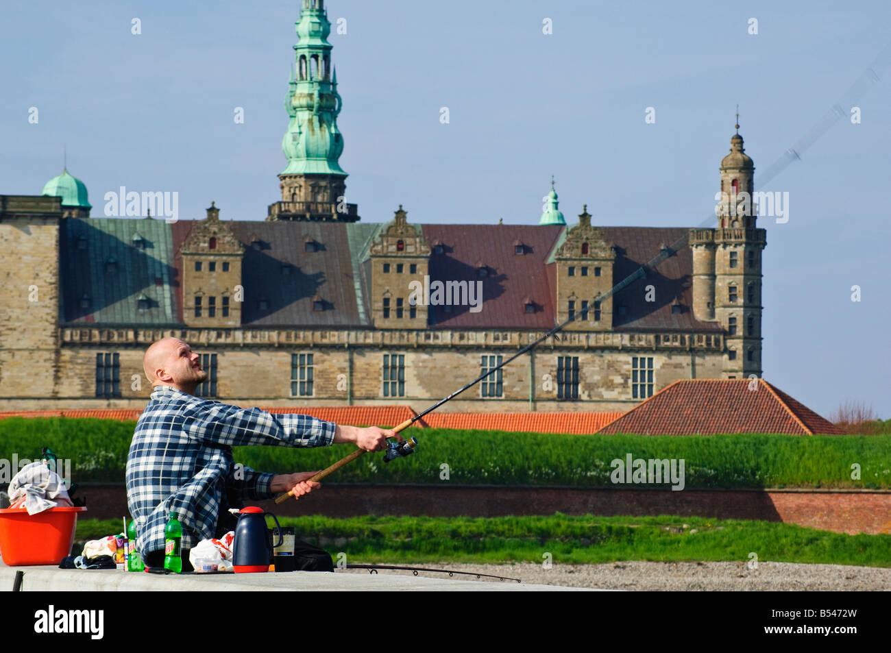 Sea angler in front of Kronborg Slot Elsinore Castle Helsingør Denmark setting for Shakespeares Hamlet - Stock Image