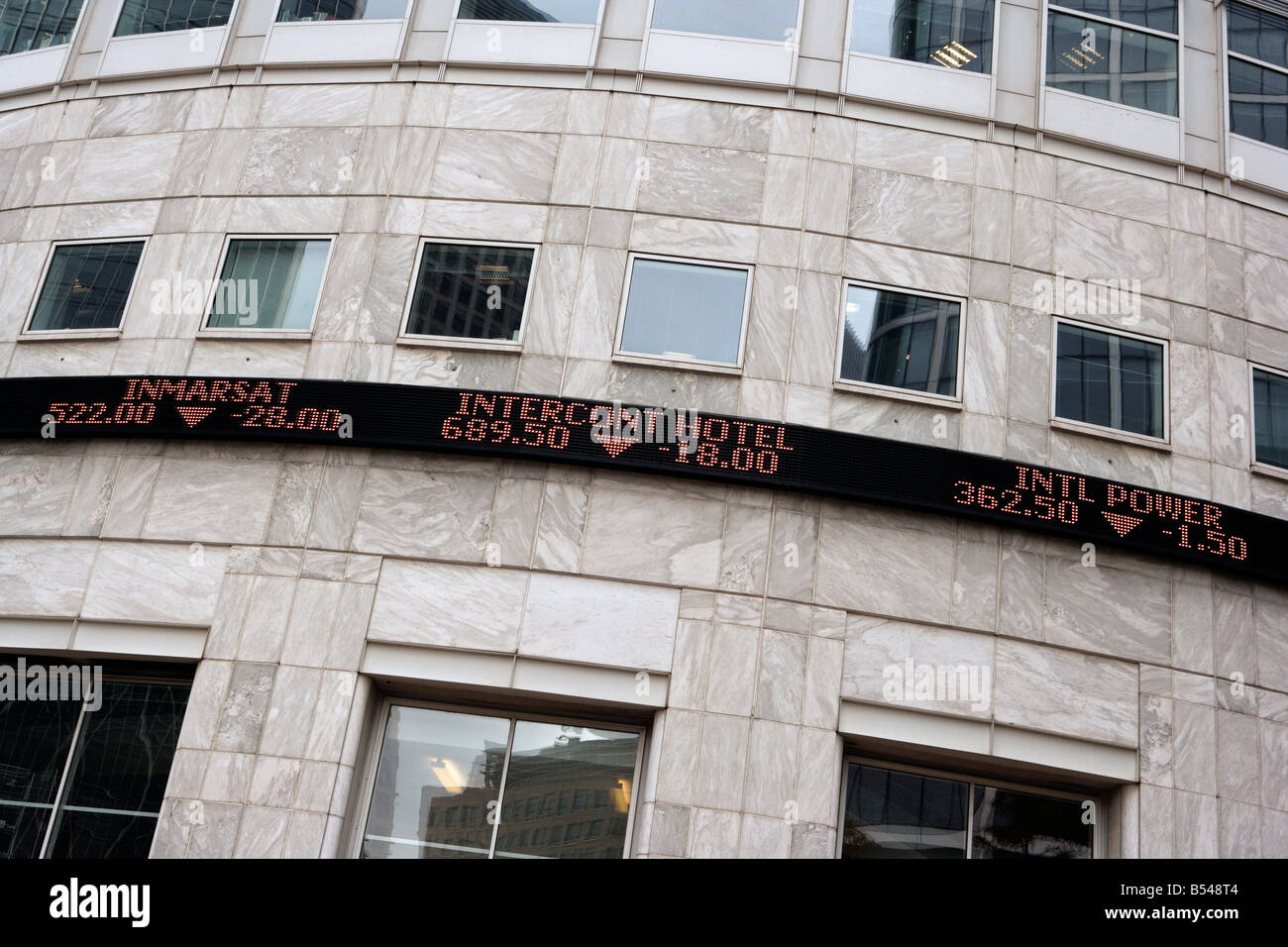 Ticker Tape Stock Prices Canary Wharf London - Stock Image