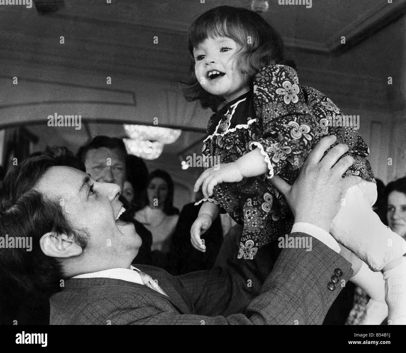 18 month old Rachel Atkinson won £1,000 at a National baby contest. Alan Atkinson and Rachel at the contest. - Stock Image