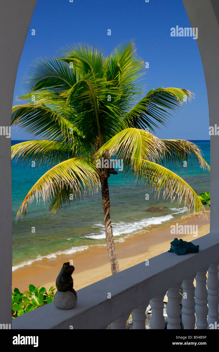 The beautiful view onto the beach and Caribbean Sea from the shoreline property in Rincón, Puerto Rico. - Stock Image