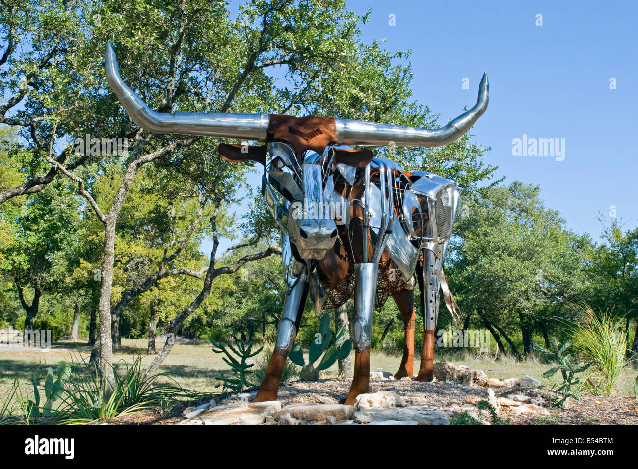 Statue of longhorn steer constructed of automobile body parts Stock Photo