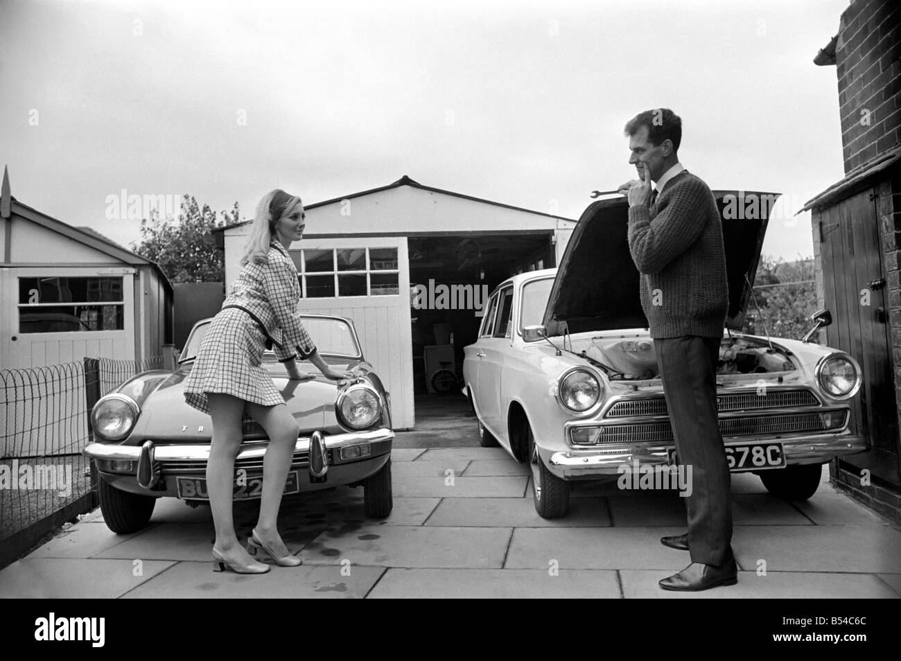 Models pose for a Lolly Dolly wives feature in Manchester. Man and woman and child in a suburban neighbourhood. Stock Photo