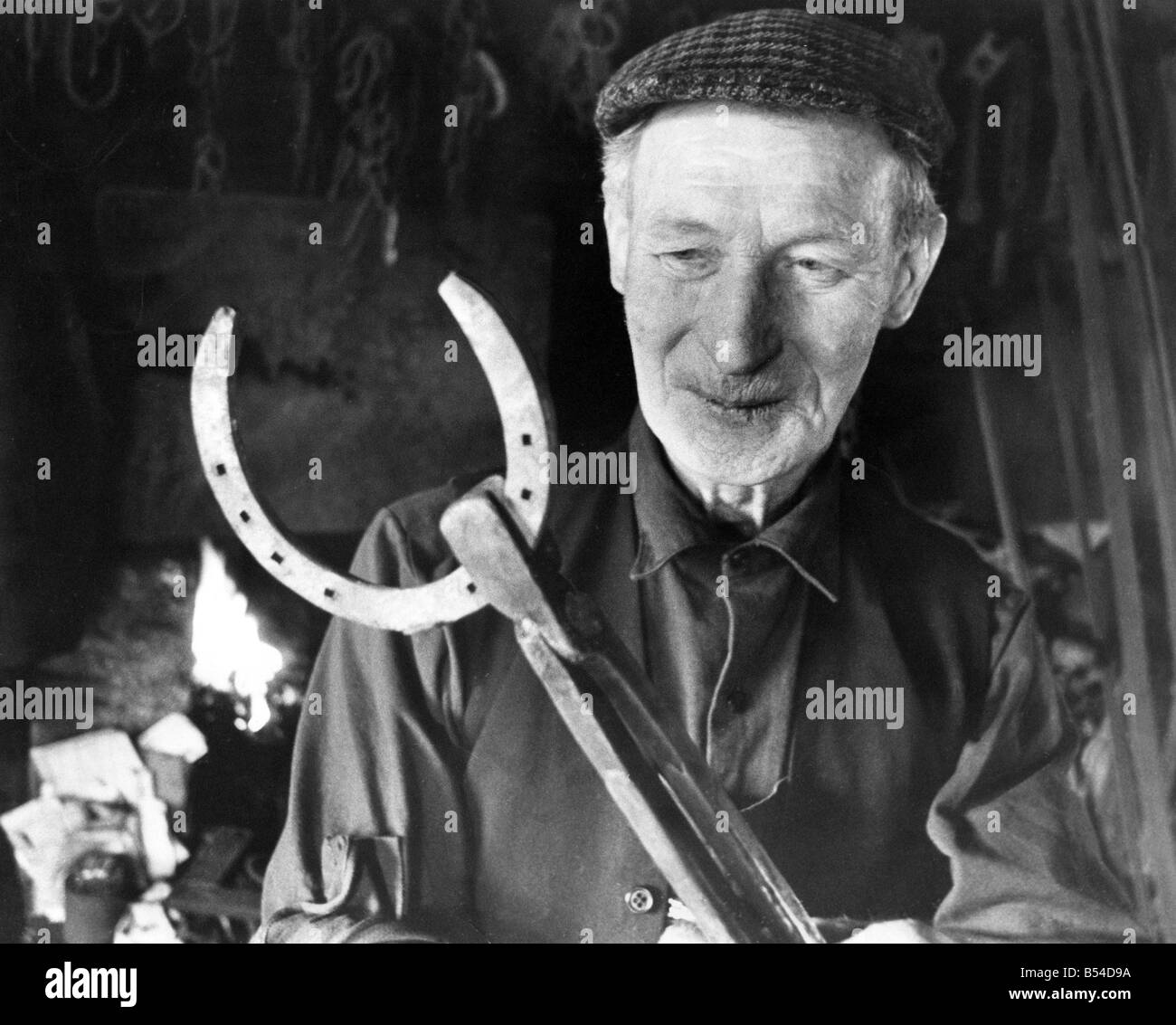 Mr Jackie Pearson the Kirkwhelpington village Blacksmith who is regarded as the farmer s friend - Stock Image