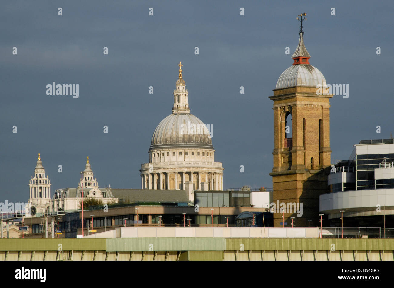 Spires of St Paul's Cathedral and Cannon Street Station above Cannon Street Railway Bridge, City of London, - Stock Image
