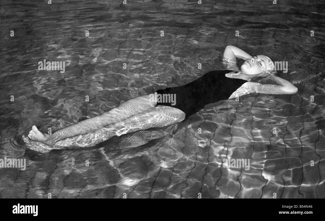 Swim Suits Unsinkable: Unsinkable swimsuit. Resting peacefully on the water during a demonstration of a unsinkable - Stock Image