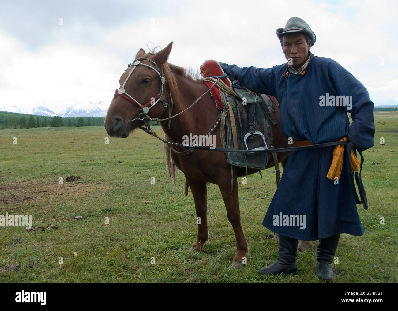 Nomad with his horse in Northern Mongolia - Stock Image