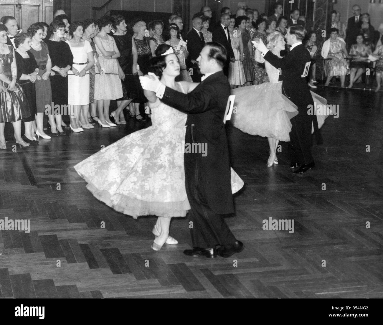 A Group Of Ballroom Dancing Couples In Old Time Dance Competition