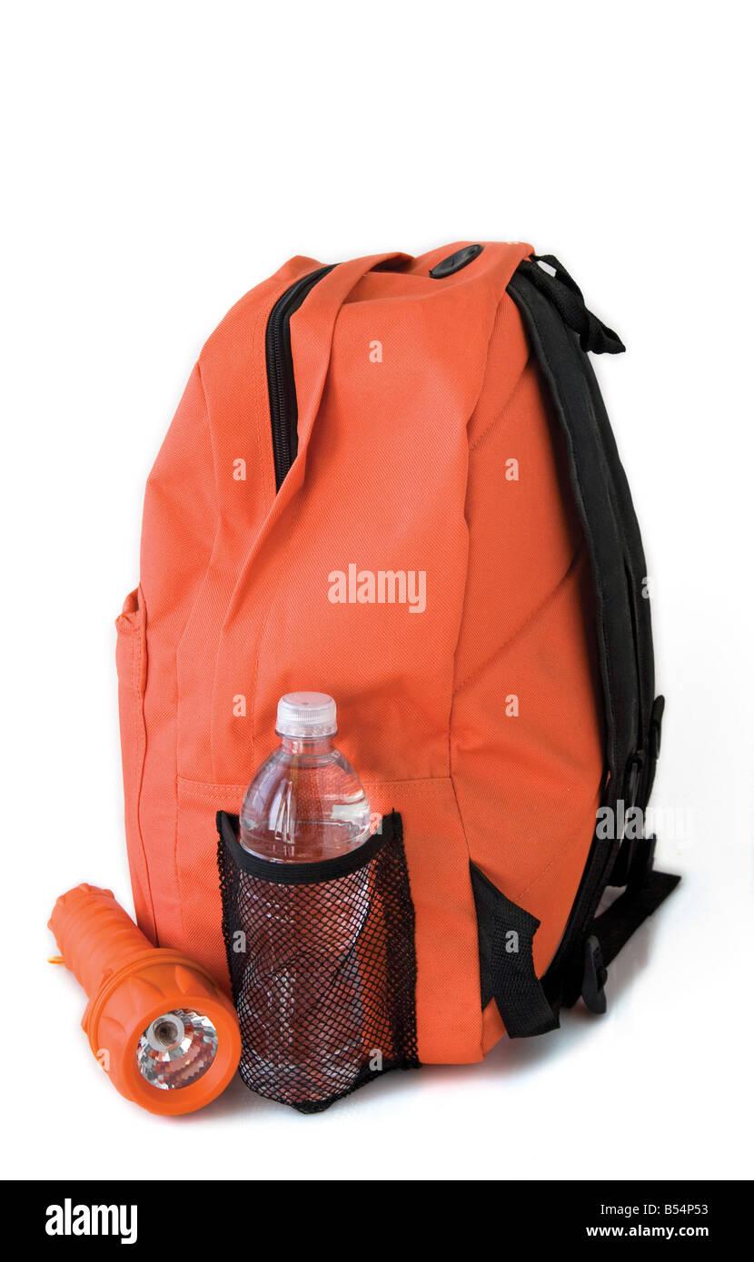 orange emergency backpack with water bottle and flashlight - Stock Image