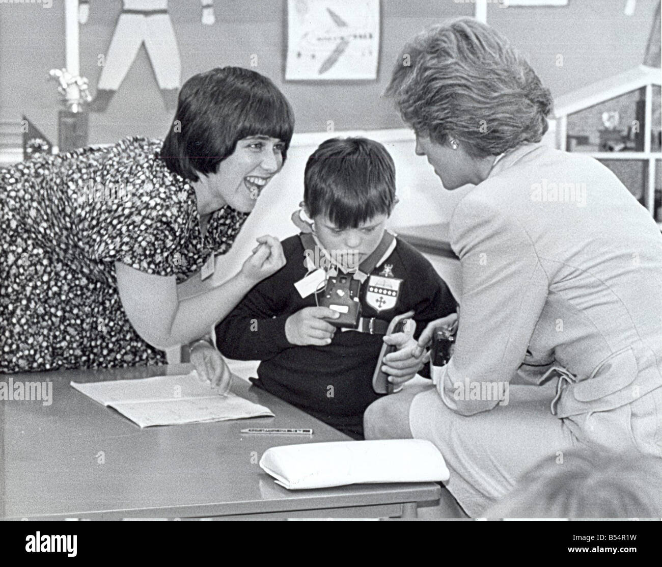 Princess Diana the Princess of Wales North East visits Teacher Miss Jean Burn translates for Barry Coyle 8 at the - Stock Image