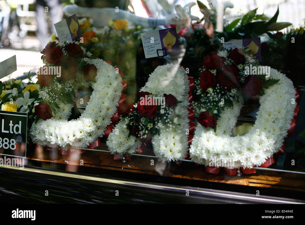 Funeral of gary newlove killed by a mob outside his warrington home funeral of gary newlove killed by a mob outside his warrington home flowers from his three daughters spelling the word dad izmirmasajfo
