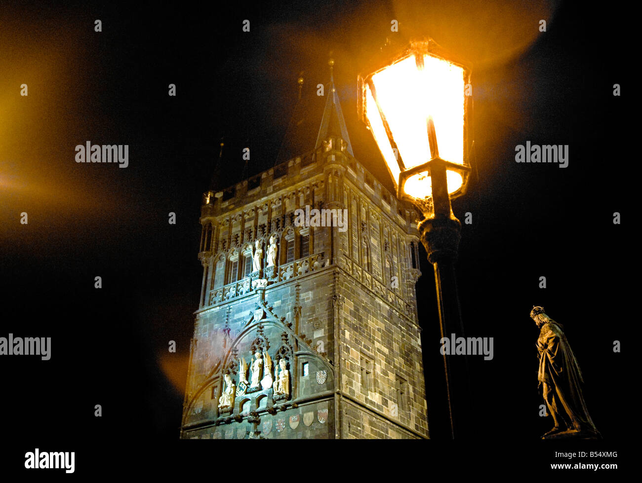 The Old Town Bridge Tower and Statue of Charles IV in Knights of the Cross Square Prague illuminated at night FOR - Stock Image