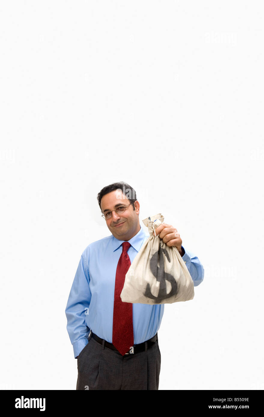 business man holds bag of money - Stock Image