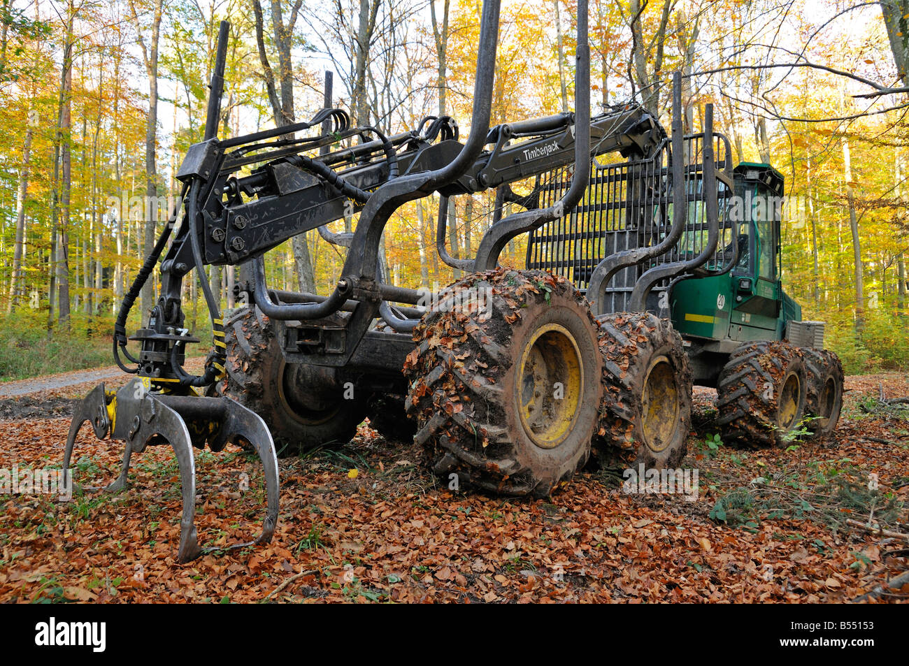 Timberjack forestry machine standing in the forest Stock Photo