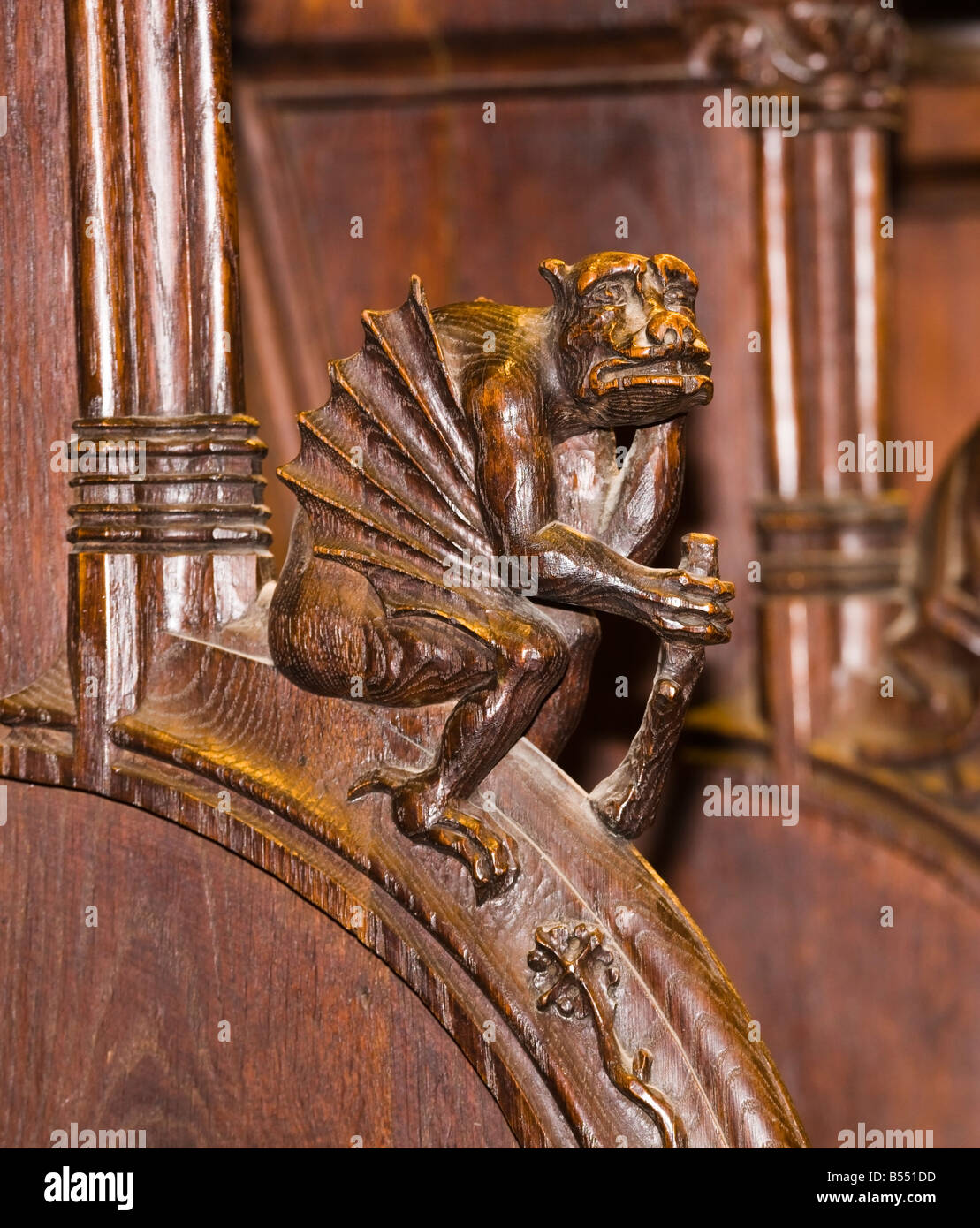 Seville Seville Province Spain Carved wooden griffin like figure on choir stall in cathedral - Stock Image