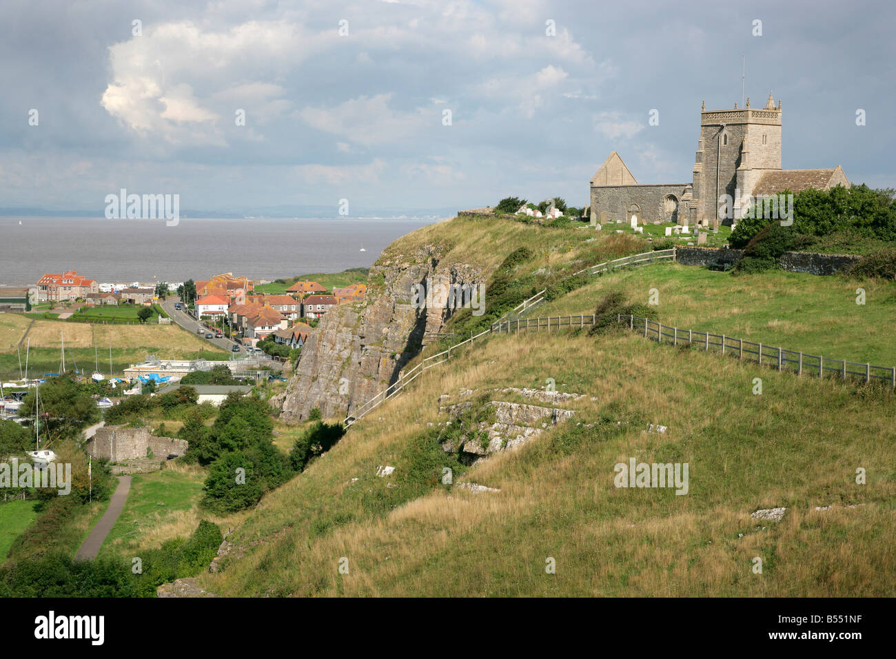 Old Church of St Nicholas at Uphill near Weston super Mare Somerset with the Severn estaury beyond Stock Photo