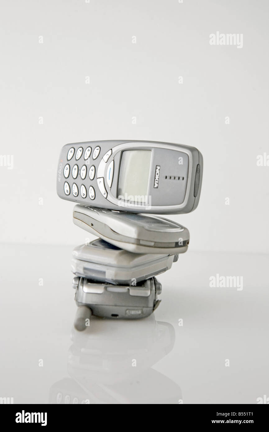 stack of cell phones - Stock Image