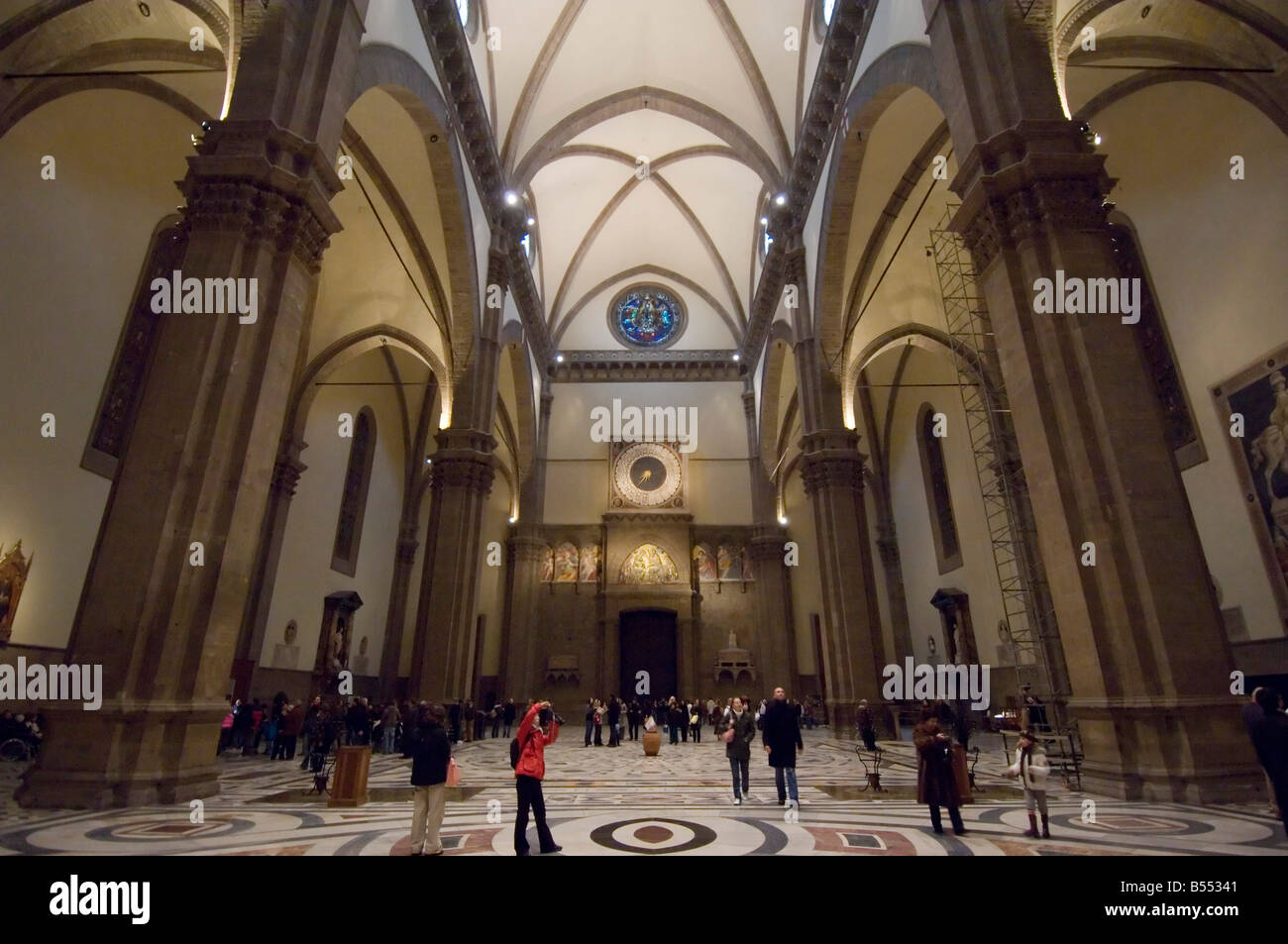 An interior view of the Basilica di Santa Maria del Fiore (Duomo) in Florence with tourists visiting and taking - Stock Image