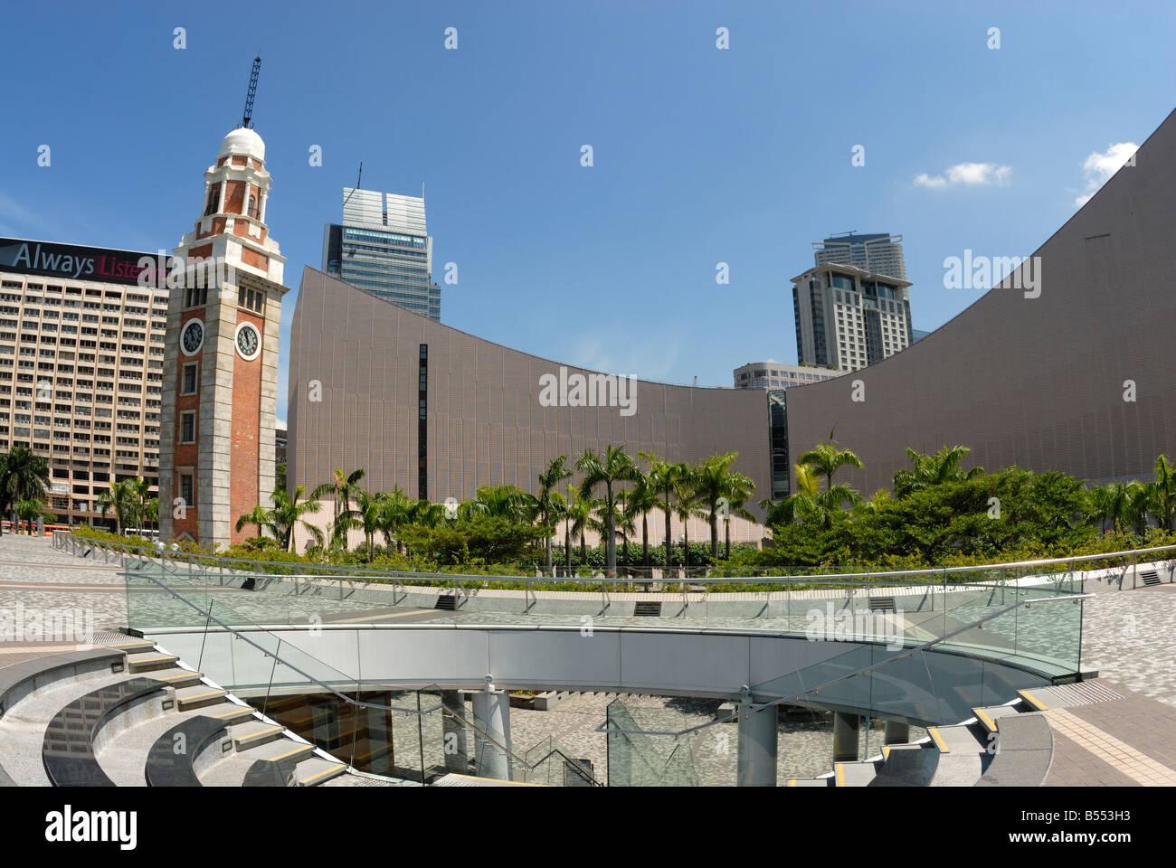 Hong Kong Cultural Centre and Tsim Sha Tsui clock tower (formerly Kowloon-Canton Railway Station terminus) Hong - Stock Image