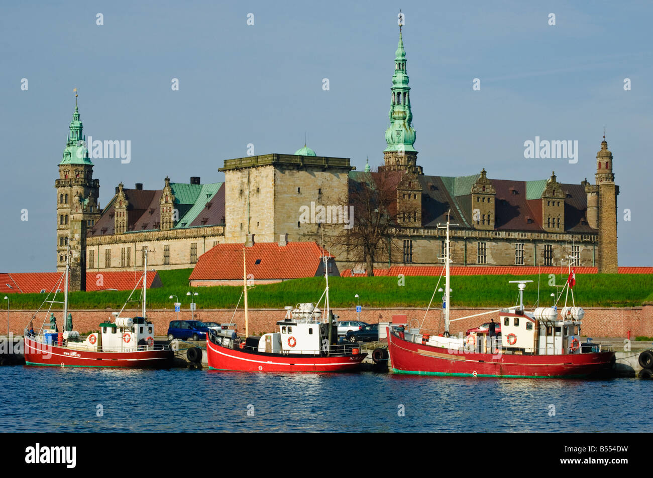 Fishing boats in front of Kronborg Slot Elsinore Castle Helsingør Denmark - Stock Image
