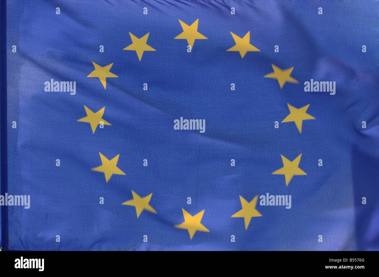 The flag of the european union filling the frame parts of it blurry because of strong wind - Stock Image