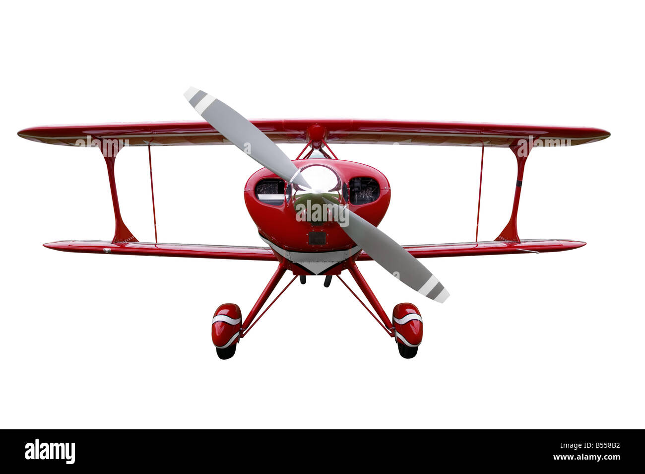 Red biplane cut out - Stock Image