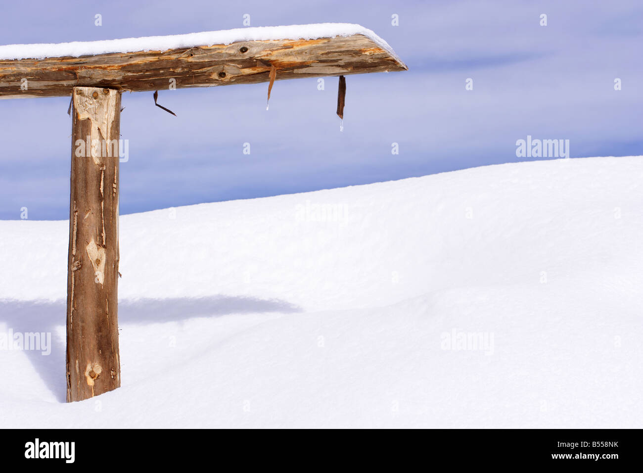 Woody fence in the snow - Stock Image