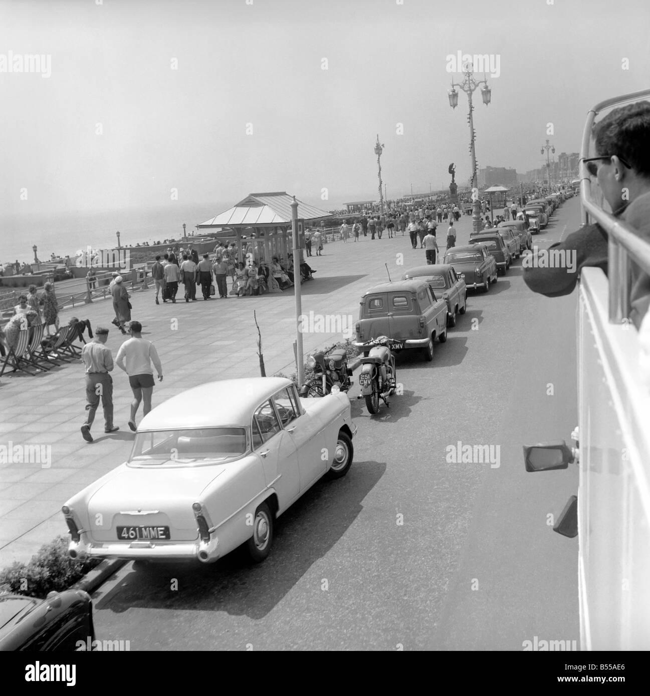 Traffic/Parked cars, street scene. June 1960 M4336-001 - Stock Image