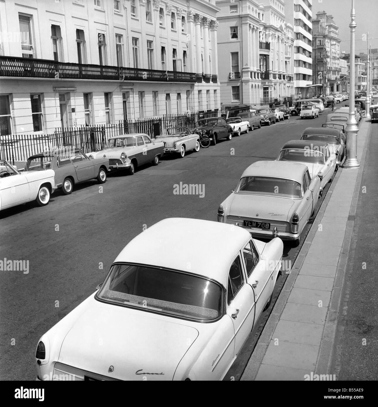 Traffic/Parked cars, street scene. June 1960 M4336-003 - Stock Image