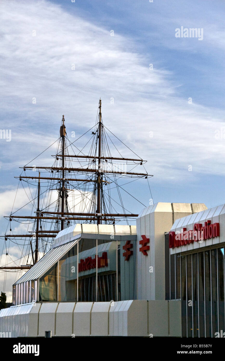 Dundee railway station front entrance with the RRS Discovery ship masts towering above in central Dundee,UK Stock Photo