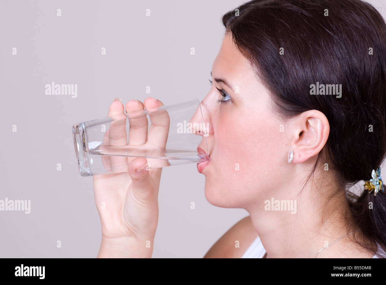 Woman drinking water - Stock Image