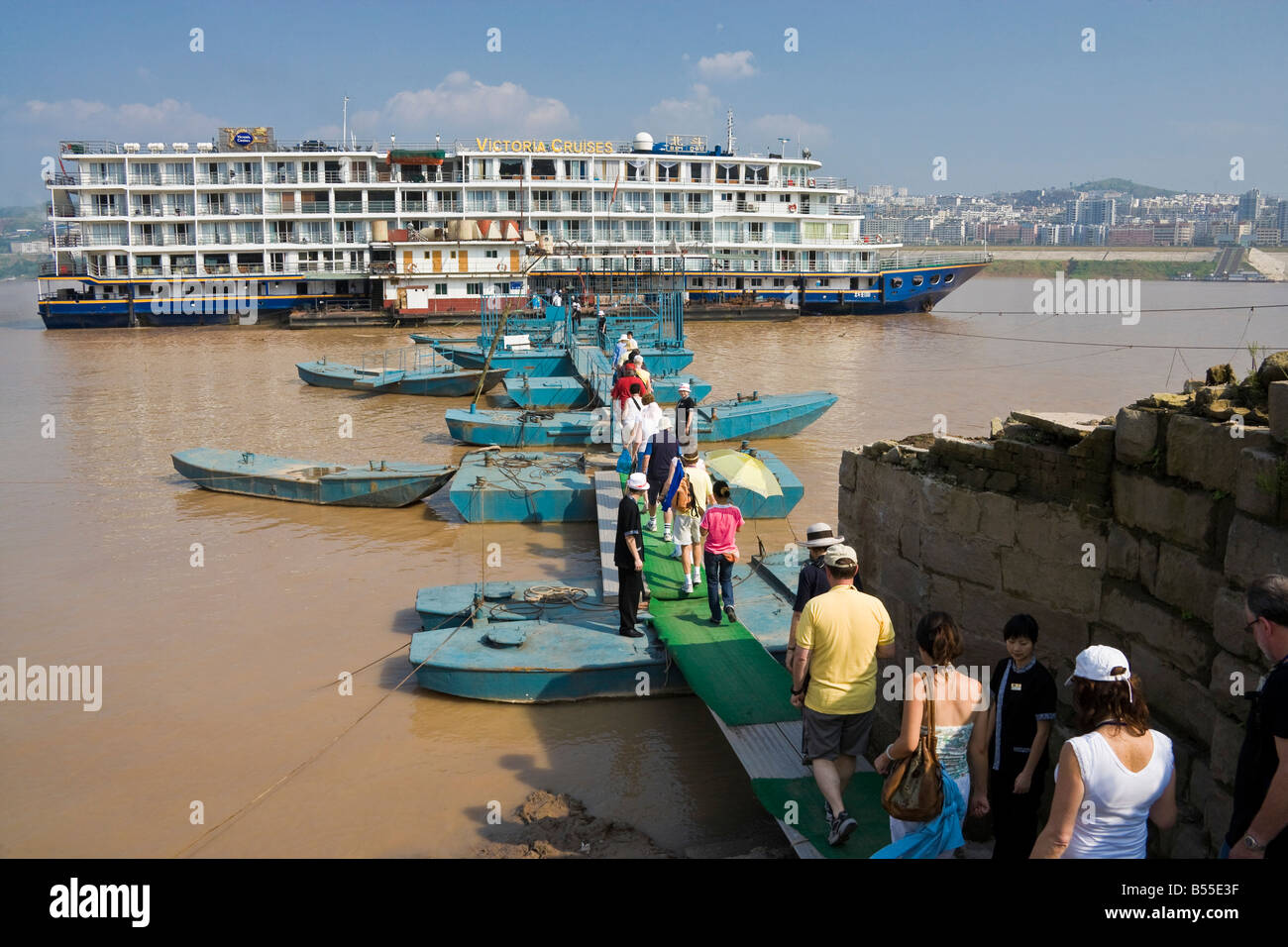 Western tourists boarding Victoria Cruises ship Bei Dou moored on the Yangzi River at Fengdu Ghost City China JMH3362 - Stock Image