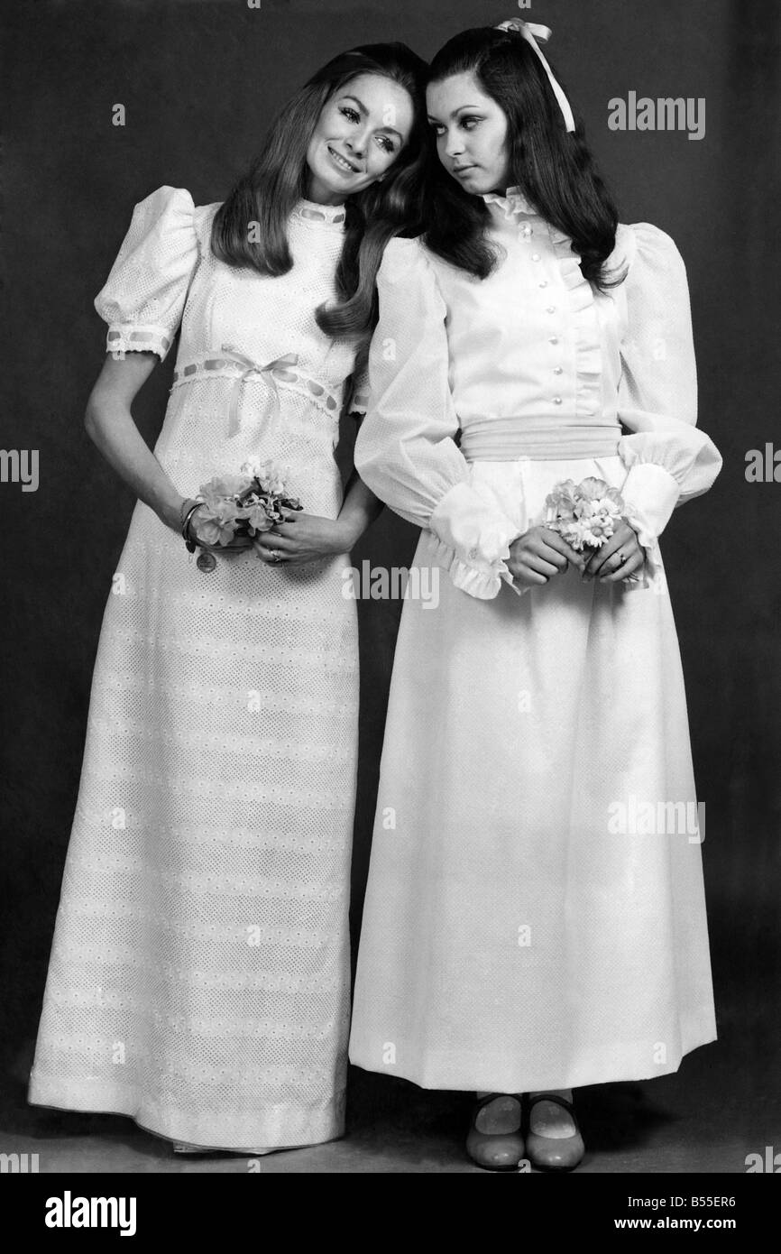 Demure in white. At left, white broderie anglaise trimmed with yellow ribbons by California;Right is a white hail - Stock Image