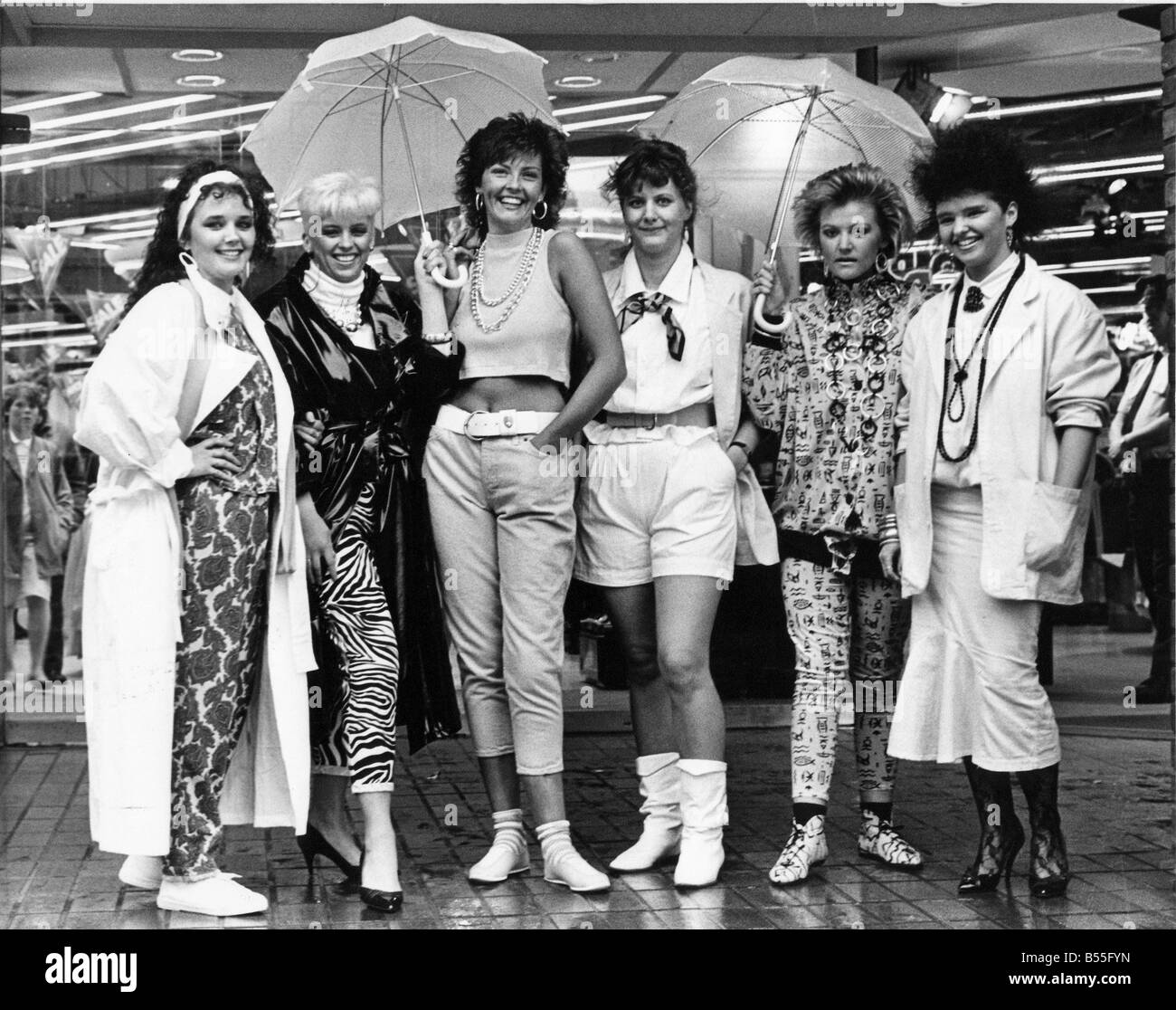 A group of models show of the latest eighties fashion - Stock Image