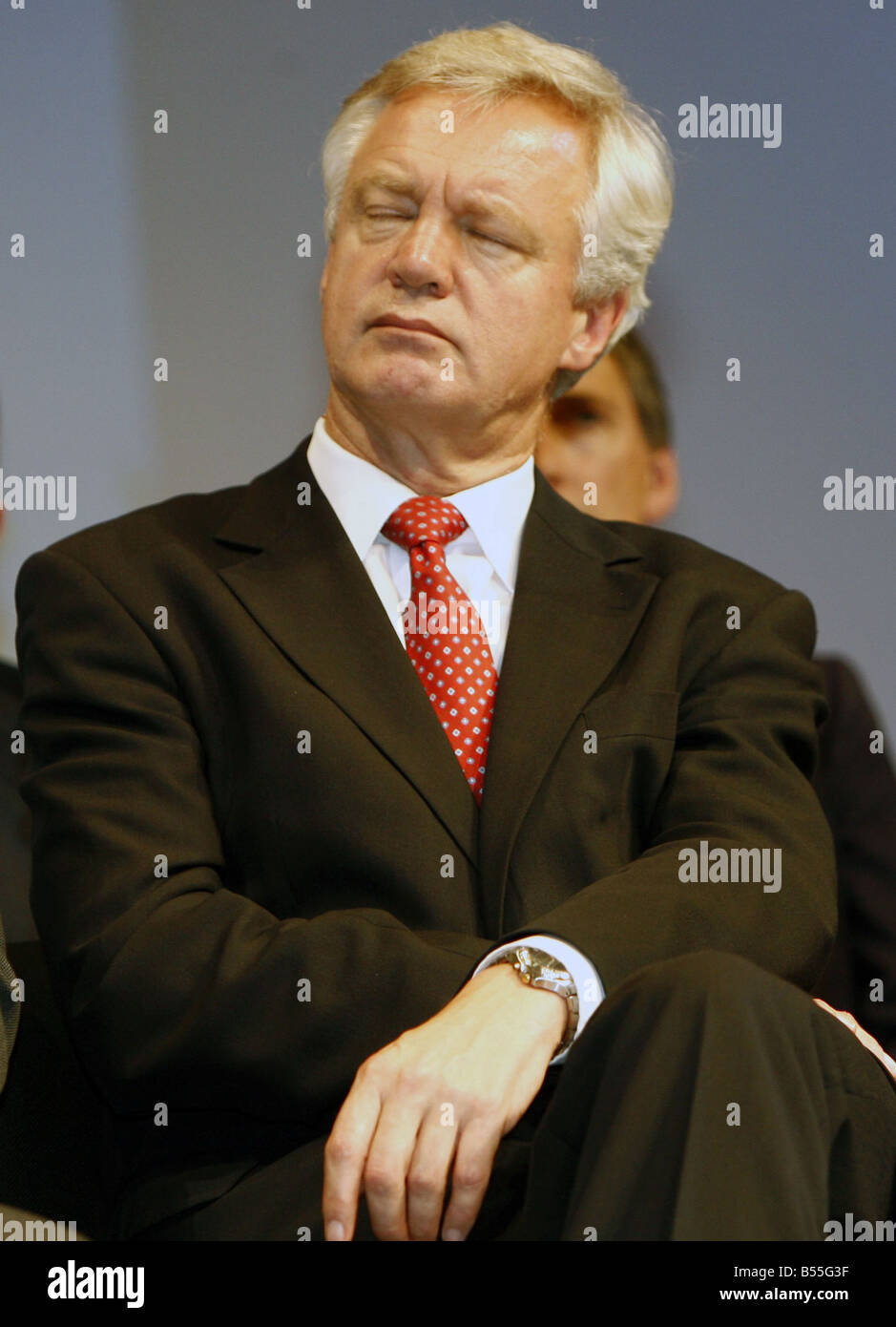 David Davis snoozes during Tory leader David Cameron s speech to delegates at 2007 Conservative Party Conference - Stock Image