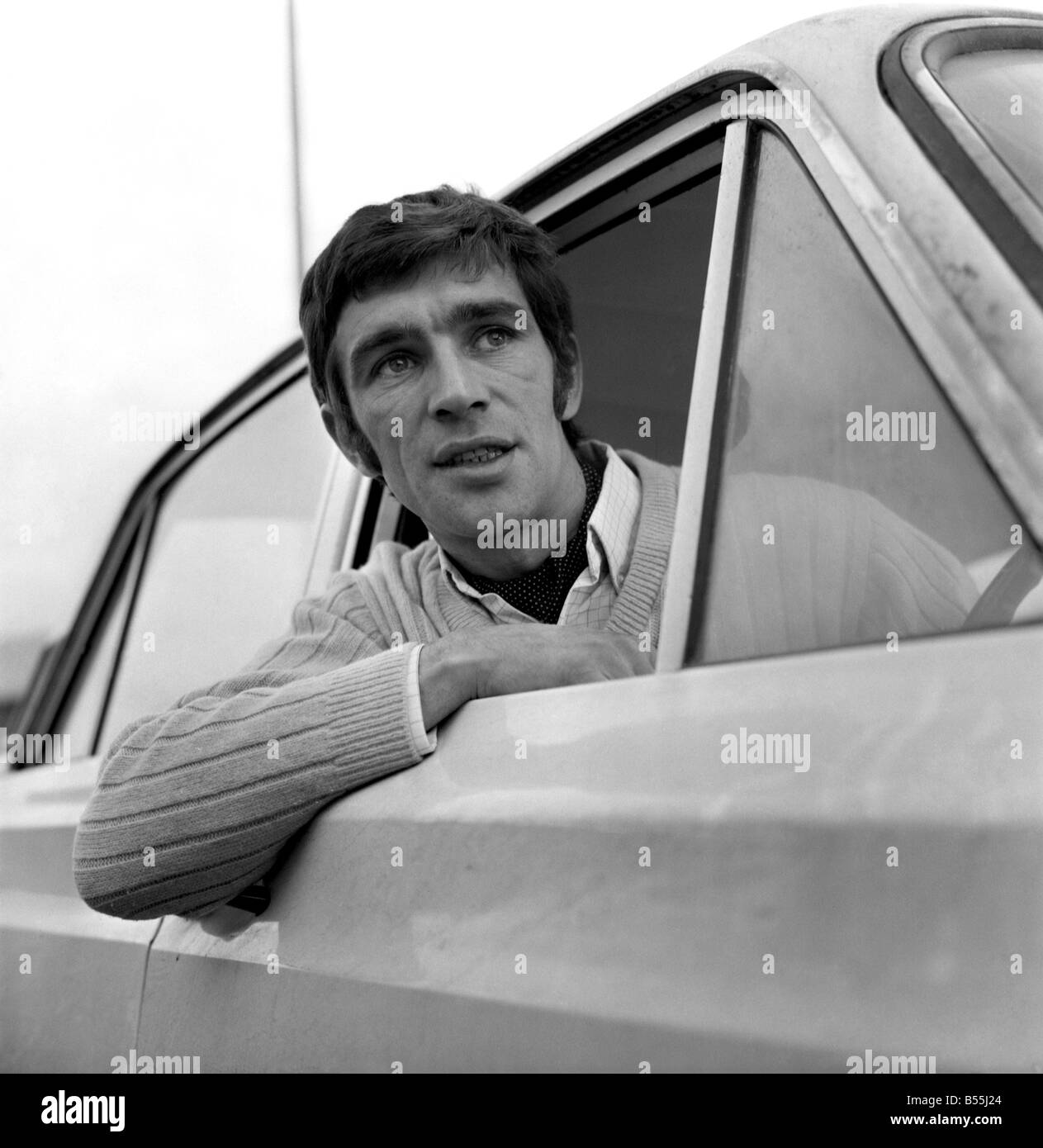 Motor: Cars. 31 year old Bryan Nash of Nunhead, S.E.15 with his 1966 MK1 Ford Cortina. December 1969 Z12139-001 Stock Photo