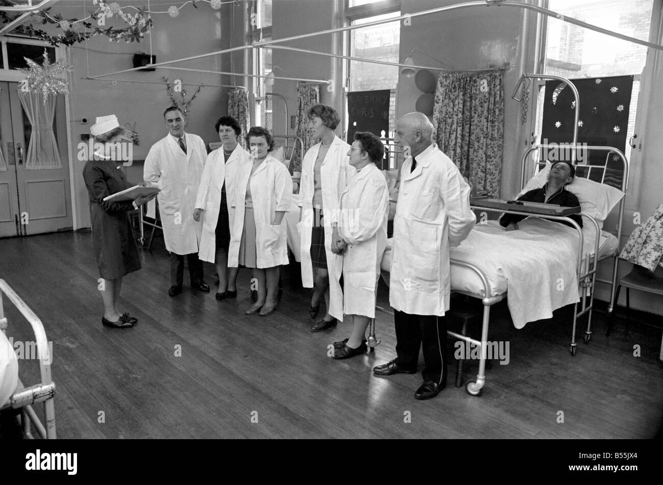 The Good Samaritans stand on parade in a hospital ward. They are some of the volunteers who stopped a small hospital - Stock Image