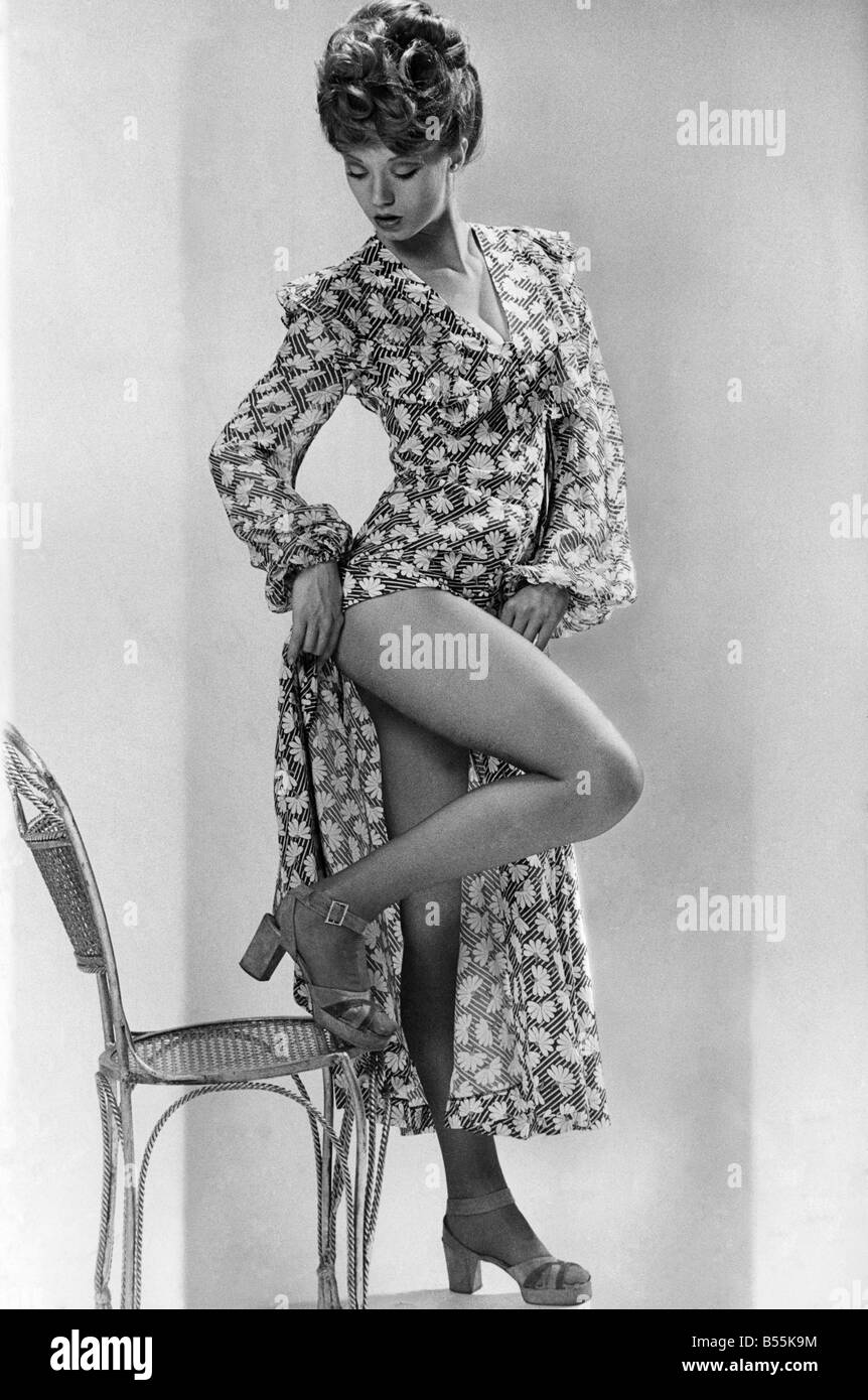 Model Vida revives the oomph of Betty Grable. Ankle length black and white print daisy dress is by Osie Clark for - Stock Image