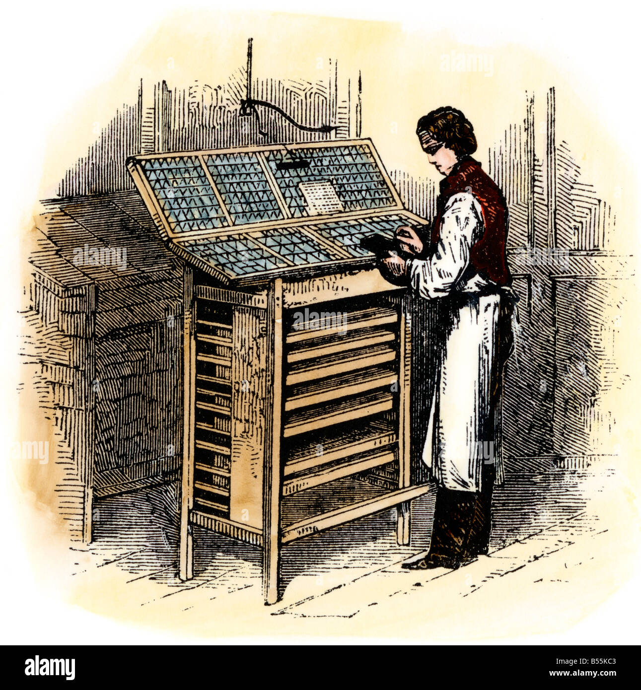 Setting type by hand in a print shop. Hand-colored woodcut - Stock Image