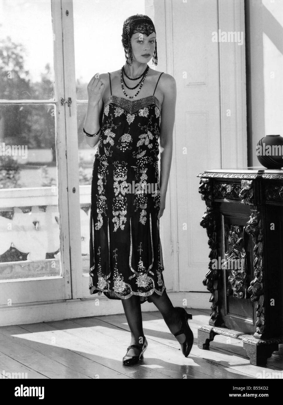 36481ecf8bfd8 Fashions 1920's: Beaded flapper dress and skull cap with neat T-bar shoes.