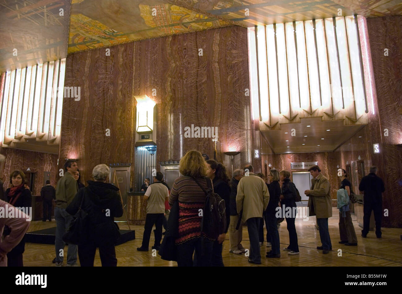 Visitors to the art deco lobby of the Chrysler Building in New York - Stock Image