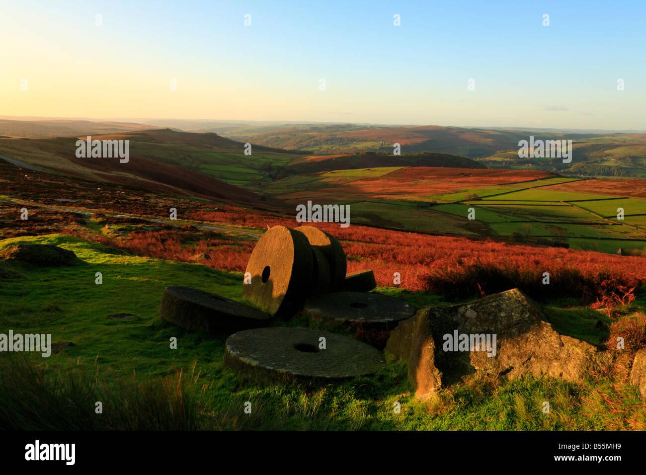 Early morning Autumn sun on millstones below Stanage Edge Hathersage Derbyshire England UK - Stock Image