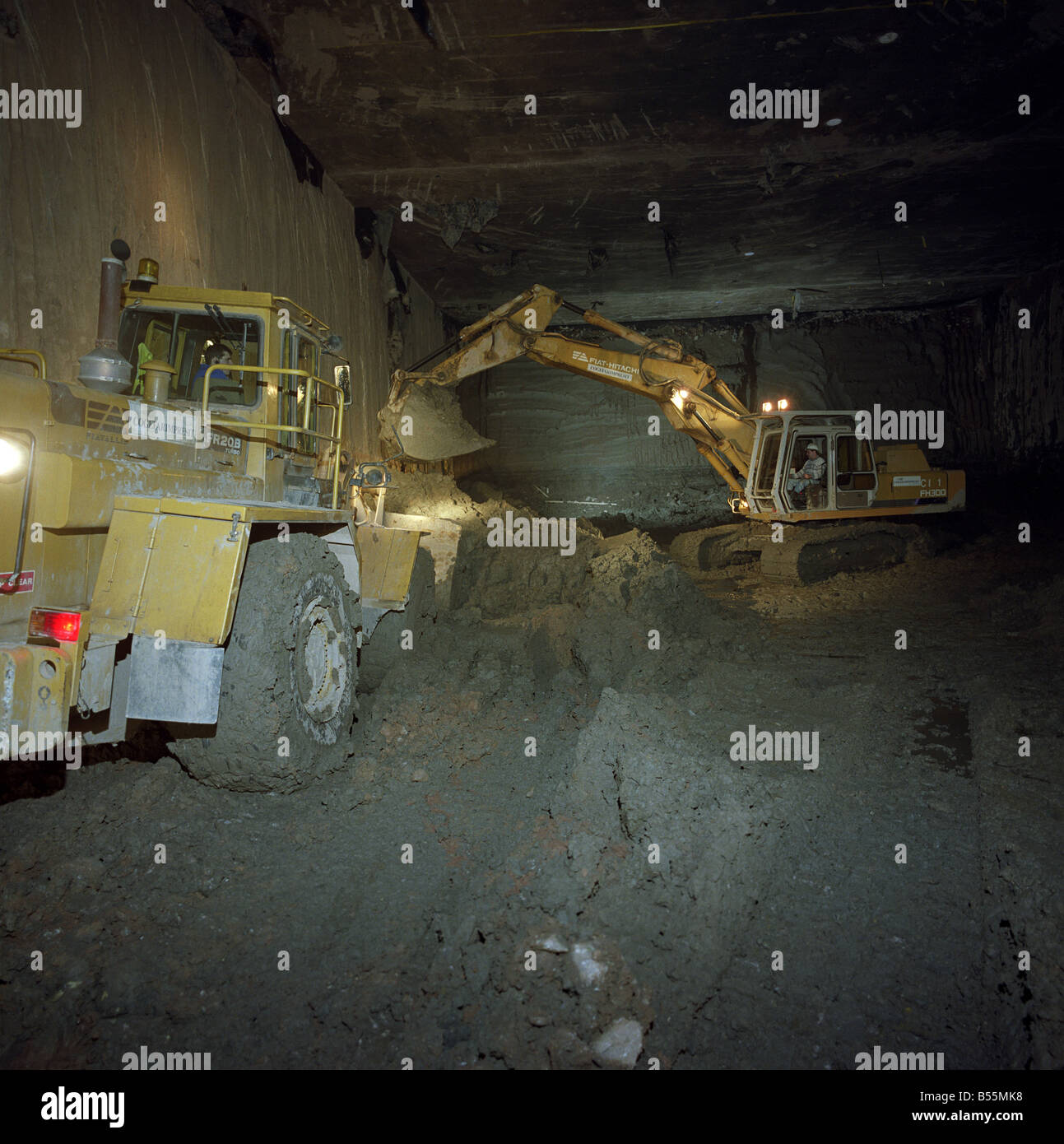 Digger working in a Tunnel - Stock Image